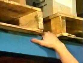 climbing a pallet rack