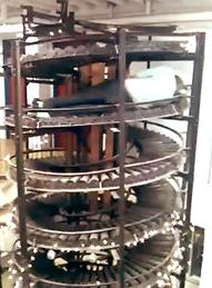 person riding on spiral conveyor