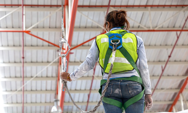 fall protection harness system in a warehouse