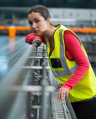 warehouse worker near a conveyor system