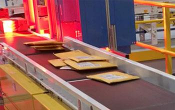 envelopes stacking on a conveyor system belt