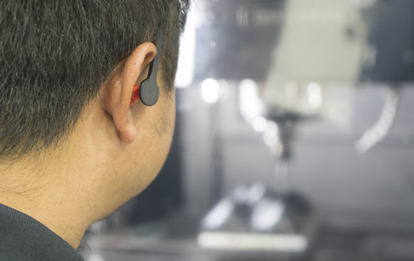 manufacturing worker with earplugs