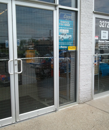 door and storefront secured by wire security panels