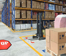 Busy warehouse with storage areas and defined forklift lanes