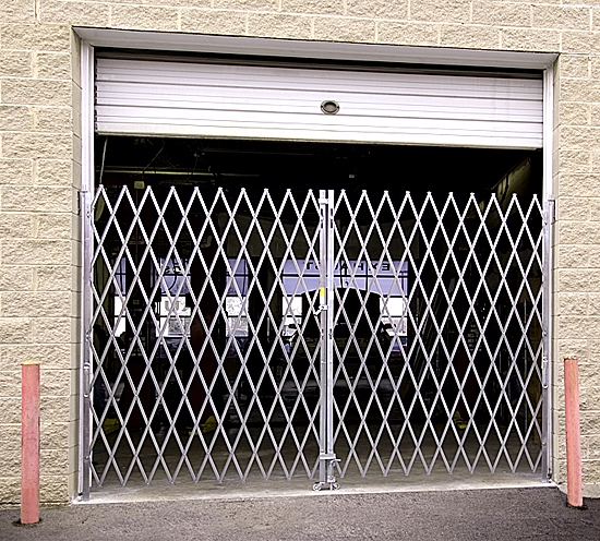 Folding security gate: warehouse dock door application
