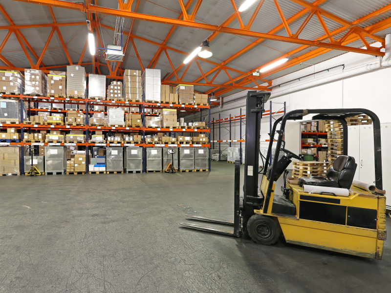Forklift in front of rack and shelving warehouse system