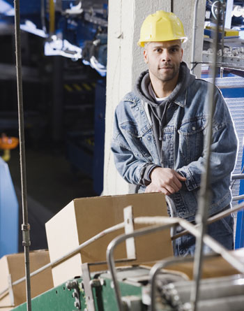 worker in a conveyor system warehouse