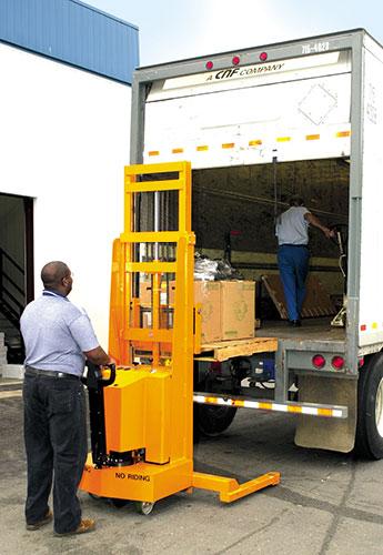 stacker unloading a truck