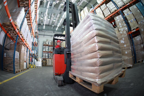 forklift in a distribution center picking aisle
