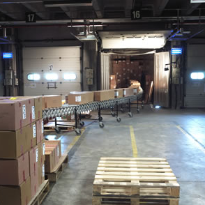 interior dock with loaded truck and conveyor