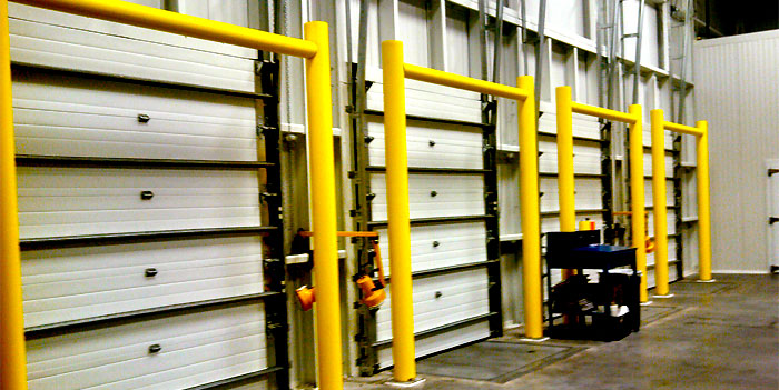 dock door protectors in a warehouse