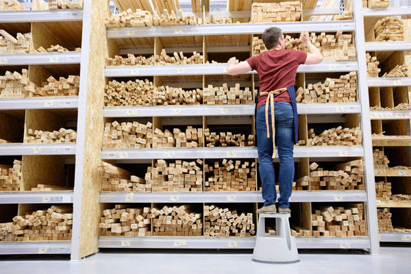 picking wood and boards from a warehouse rack