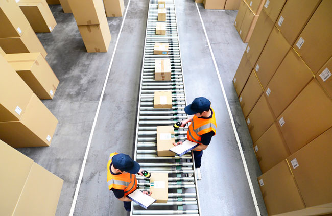 warehouse workers with cartons