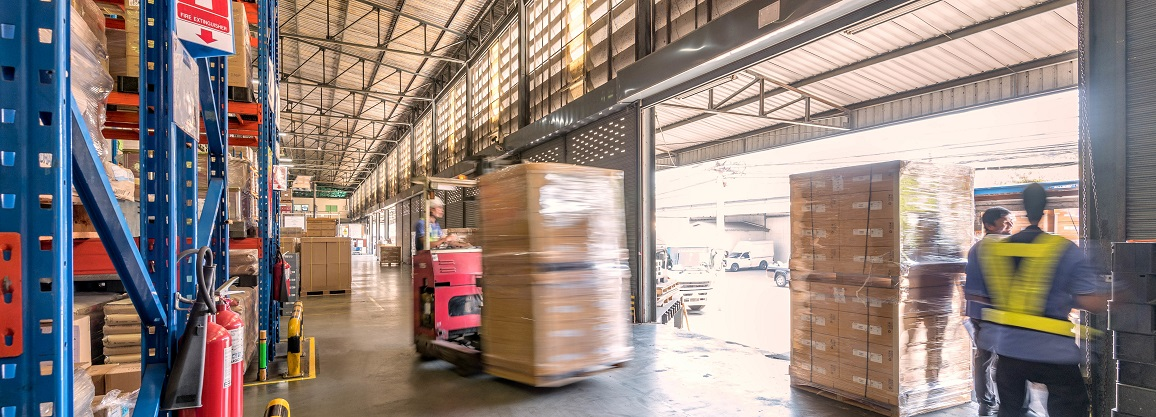 loading dock with forklifts moving
