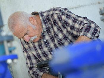 elderly worker in a factory