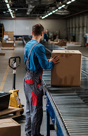 warehouse order picking cartons off a conveyor system