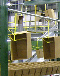 overhead conveyor in a distribution center with empty box loads