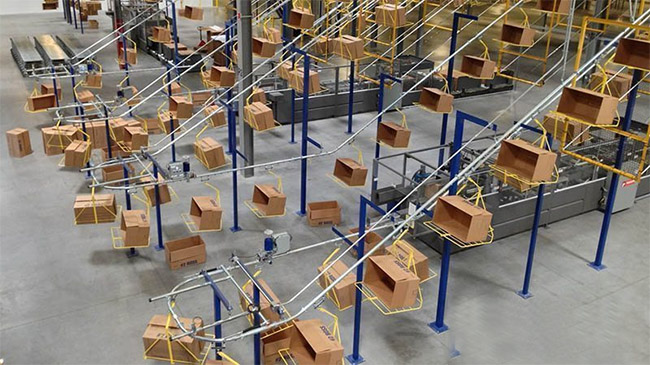 overhead conveyor transporting empty boxes