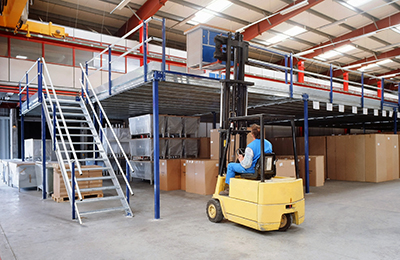 forklift loading a pallet onto a mezzanine platform.