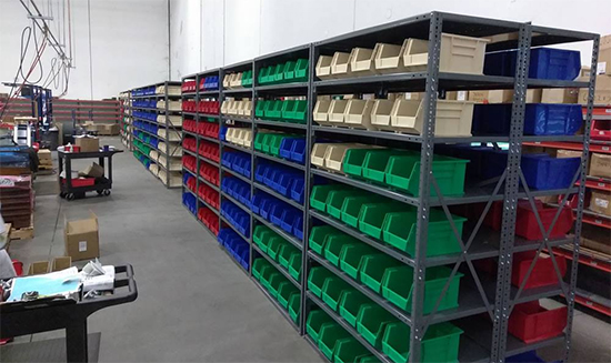 Shelving system with storage bins.