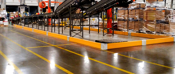Guardrail protecting mezzanine legs and stairs.