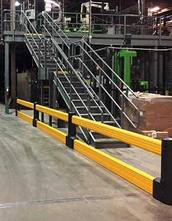 Guardrails surrounding a conveyor system.