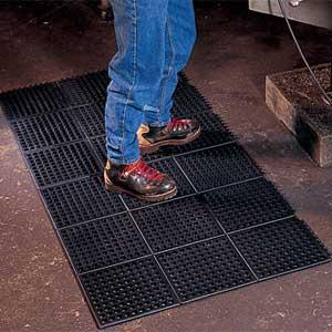 worker standing on floor mat