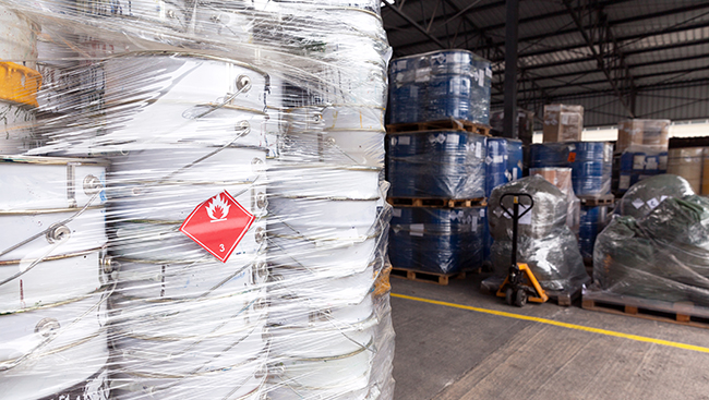 Flammable liquids stacked on a warehouse floor