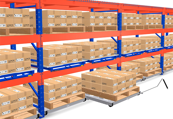 pallet rack row with roll-out pallet system to reduce ergonomic issues related to bending and stretching.