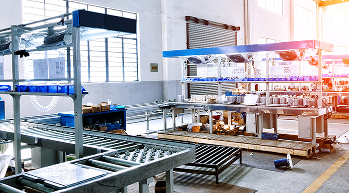 assembly line with integrated conveyors and workstations.