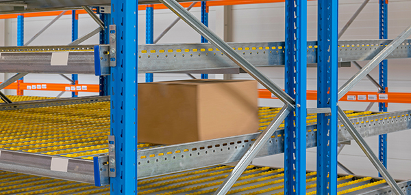 carton flow lanes inserted into pallet rack.