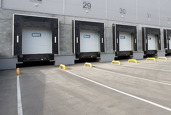 Tuck loading dock with painted guides and guardrails.