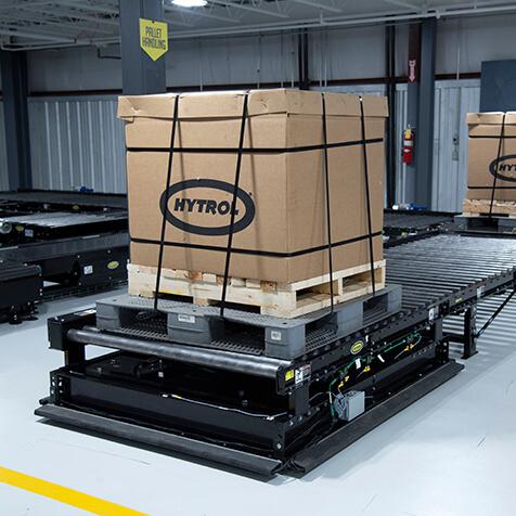 Chain driven live roller pallet conveyor