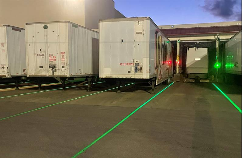 Dock lasers work in darkness, helping drivers find the right lane at a busy receiving dock.