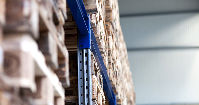 Pallet rack system in a warehouse carrying heavy pallet stacks.