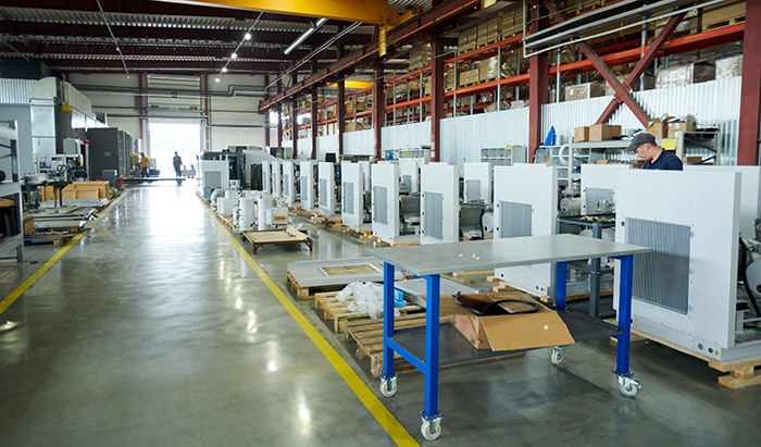 A warehouse with a broad, clean and unobstructed traffic aisle.