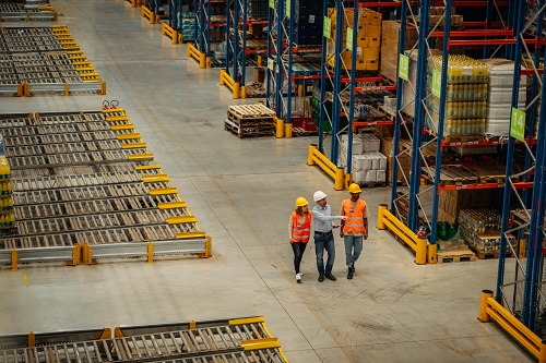 warehouse workers walking and evaluating facility