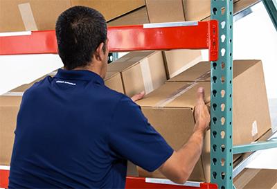 Picking heavy boxes from tilt shelves.
