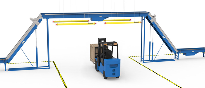 collision bars protecting conveyors from forklift impacts in an underpass application