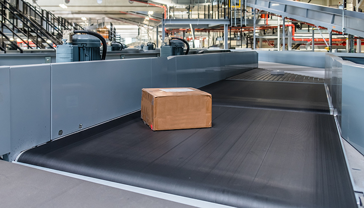 parcel conveyor system in a warehouse fulfillment operation.