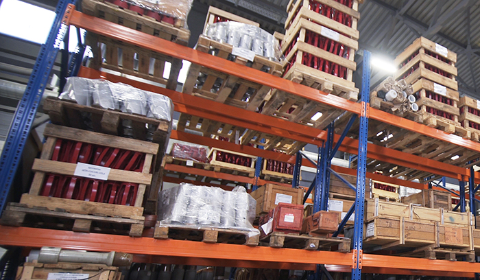 Heavy duty pallet racks with loaded beams, cartons, pallets and other heavy items.